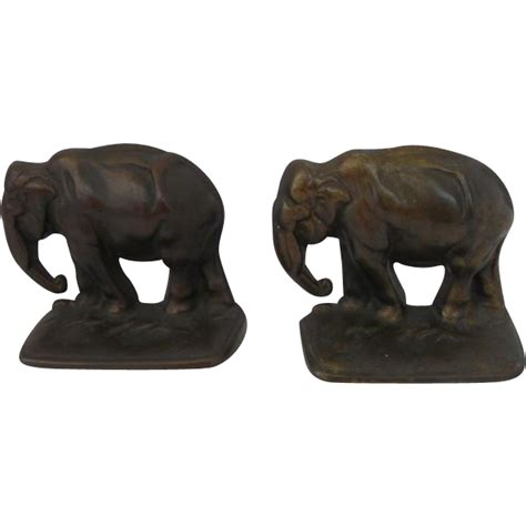 pair of vintage finish cast pair of cast iron bronze finish elephant bookends c 1920 from vintagebymandr on ruby