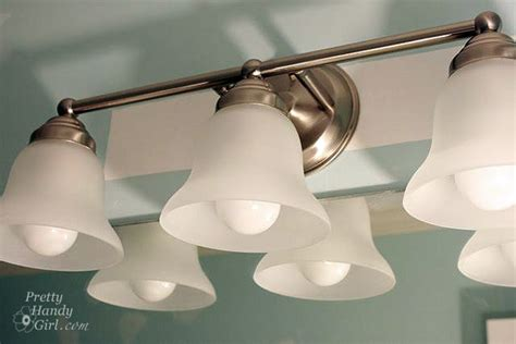 how to replace bathroom vanity light changing out a light fixture bye bye hollywood strip