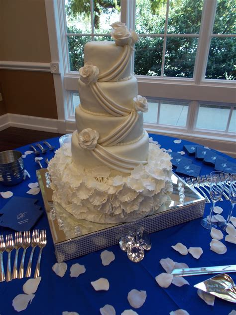 tier  wedding cake covered  fondant  roses drapes  rose pedals