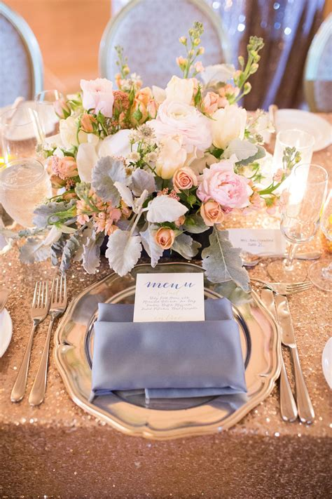 indoor wedding reception place setting silk grey napkins