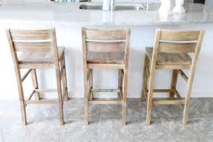 coastal distressed wooden bar stools with ladder backs on