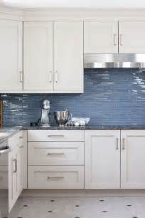 blue tile kitchen backsplash blue grey kitchen glass splashback tiles are a strong contrast to the all white cupboards