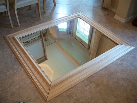 wood trim around bathroom mirror how to make a builder grade mirror look good life with