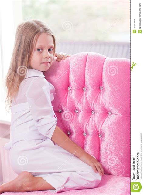 little girl on chair little girl sitting on the chair stock photography image