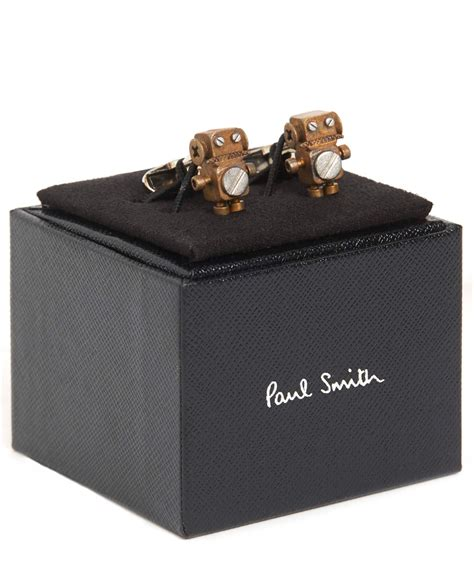 In The World Of Metallic Accessories Bronze A Clutch Named For An Equally Fashiontribes Fashion lyst paul smith bronze tone robot cufflinks in metallic