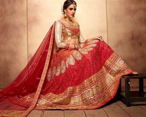 Designer Bridal Wear by Expensive Bridal Lenghas Buyinjg Usa Orange