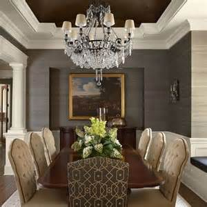 dining room with recessed ceiling painted a color with textured wallpaper and