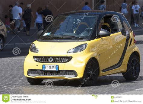 who manufactures the smart car smart automobile car yellow editorial photography