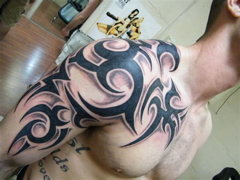 tribal tattoo on chest and shoulder tribal tattoos designs ideas and meaning tattoos for you