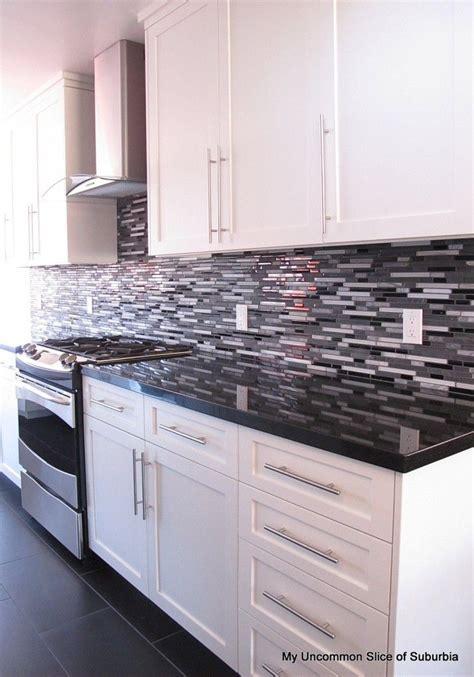 gray backsplash dark cabinets modern kitchen remodel kitchens modern and black
