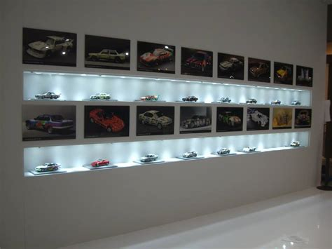Car Display Shelf by Diecast Models Displayed With Pictures Of The Actual Car