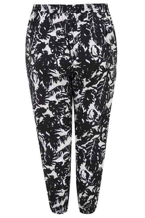 The B Club Leaf Print Black black and printed harem trousers with tie waist 14
