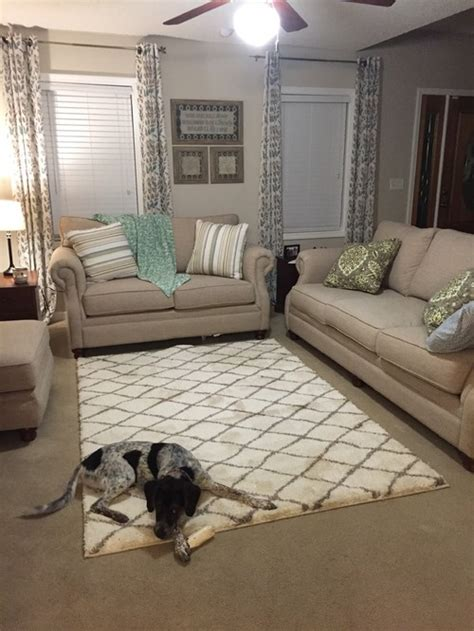 rug on top of carpet yes or no to area rug