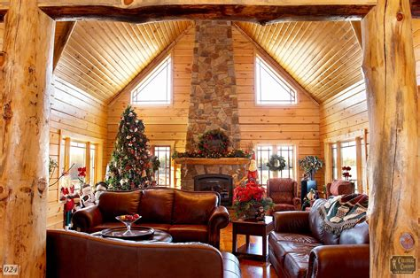 log home living room with fireplace and posts at