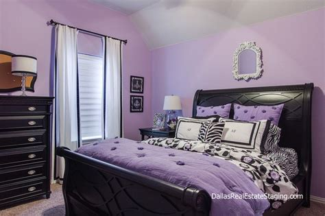 lavender bedroom room decked out in black furniture and white accents room