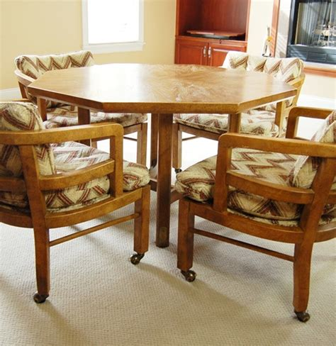 table chairs with casters octagon shape table and four chairs with casters by