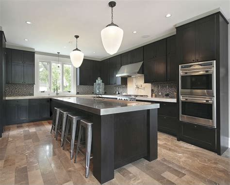 kitchens with dark cabinets and light countertops dark cabinets grey countertops and light wood floors