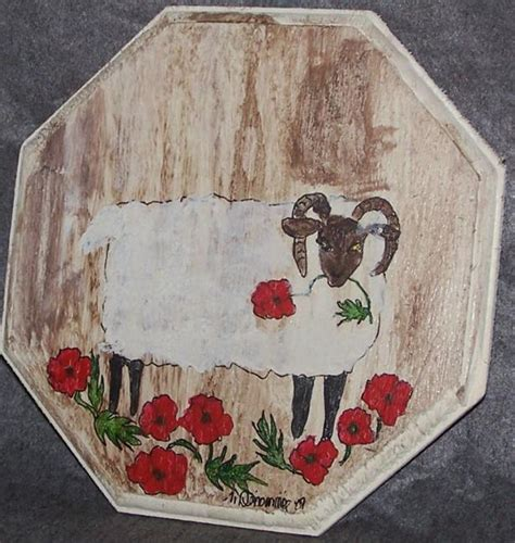 folk acrylic paint on wood curly ram with poppies by nancy denommee from folk