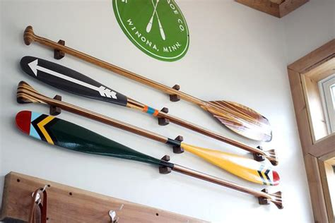 how to hang oars or paddles in an x shape the inspired wood paddle hanger sanborn canoe co