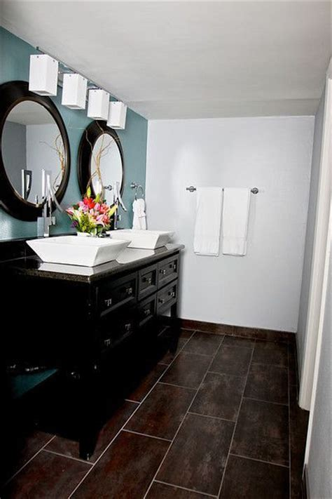 dark floor bathroom ideas dark floor dark cabinetry blue wall elle decor