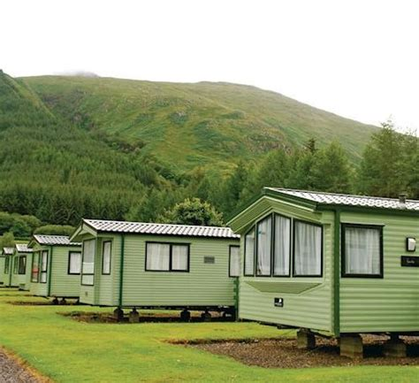 Log Cabins With Tubs In Loch Lomond by Loch Awe Park