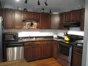 kitchen ideas with stainless steel appliances dark wooden kitchen cabinet with stainless steel appliances for formal kitchen decorating ideas