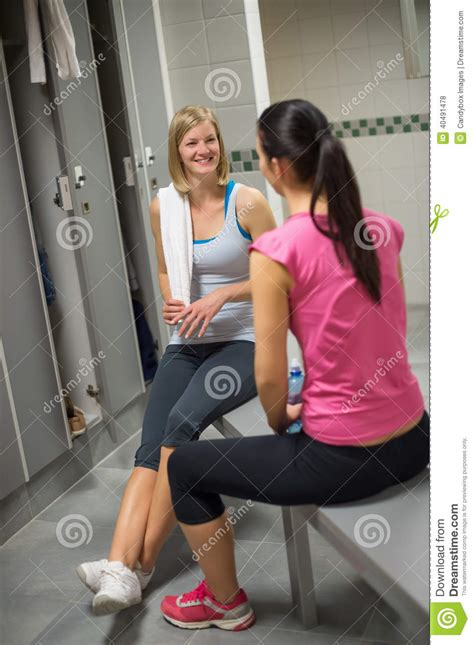 in womens locker room sitting with friend in locker room stock photo image 40491478