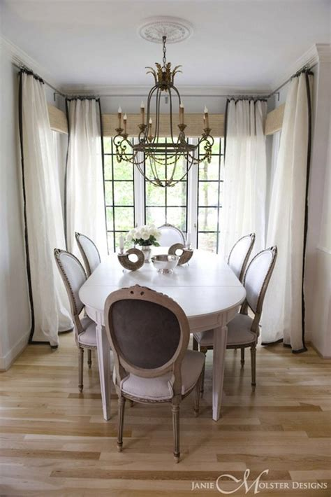 in a white room with black curtains white and black curtains french dining room janie