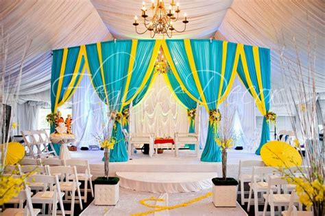 turquoise and yellow turquoise yellow fabric mandap by elegance decor chicago