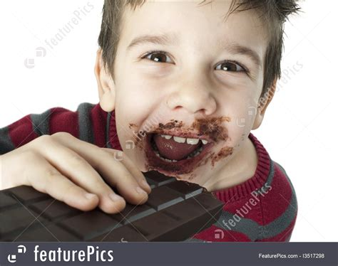 children boy eating chocolate stock picture