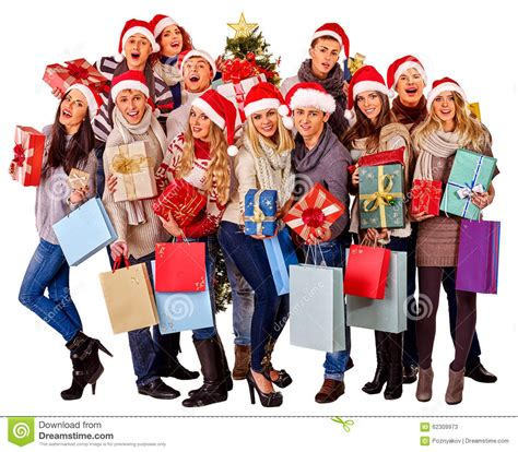 girl in santa hat holding christmas gift box stock photo
