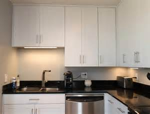 White Kitchen Cabinets Hardware White Contemporary Kitchen With Brushed Nickel Hardware
