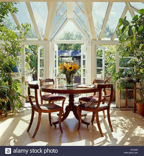 Conservatory Dining Table Antique Circular Table And Antique Chairs In Conservatory Stock Photo Royalty Free Image
