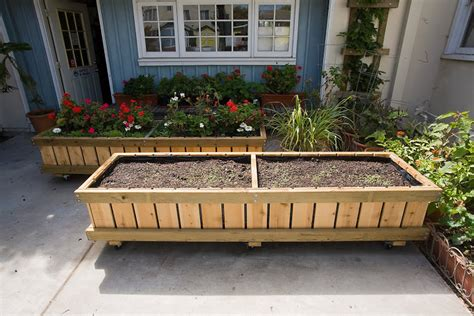 Rolling Planter Boxes by Raised Bed Planters On Wheels