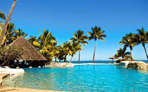 water ocean sun summer tropical fiji palm trees huts