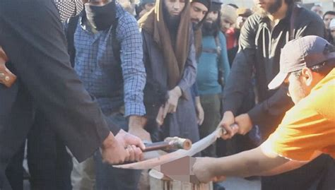 isis sliced off syrian boys fingertips in failed bid to photos horrific moment isis chops off thief hand by sword