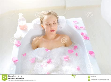 girl on girl in bathroom attractive girl relaxing in bath on light background stock