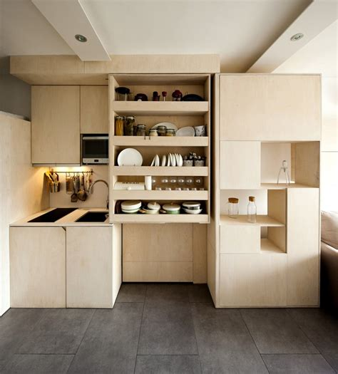 215 square feet transforming box makes it possible for family of three to