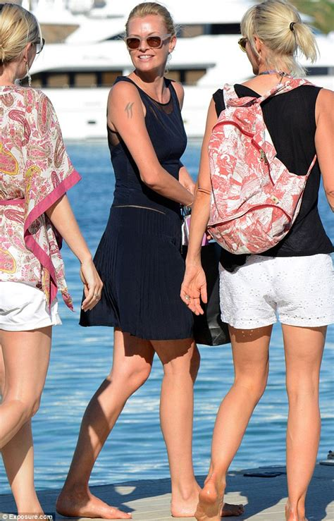 sarah murdoch shows faded dolphin tattoo with husband