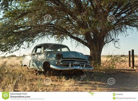 car with tree image blue vintage car tree stock images image 30488824