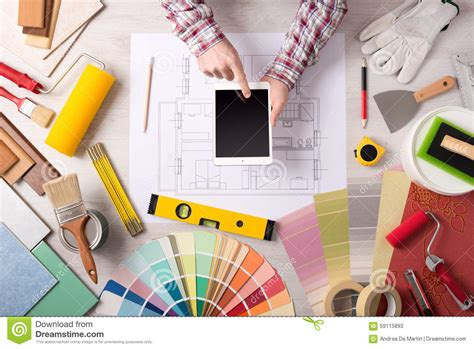 professional decorator professional decorator working at desk stock photo image