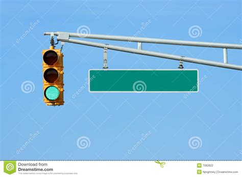 blue lights on traffic signals green traffic signal light with sign stock photography
