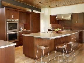 Interesting idea for small kitchen with island and bar chairs