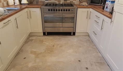 Diy Kitchen Floor Diy Lover Completely Reved His Kitchen Floor With Pennies