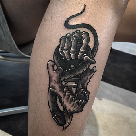 dagger skeleton snake tattoo  leg  tattoo ideas