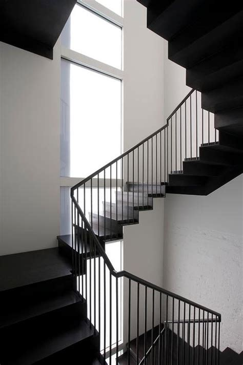 black staircase painted stair case eclectic entrance foyer
