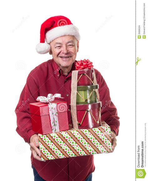 smiling happy senior man bearing christmas gifts stock