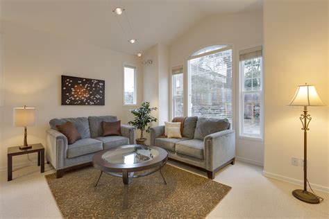 A Living Room With Two Loveseats Creating Interiors