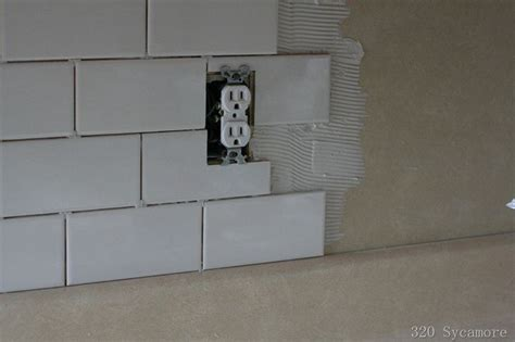 installing backsplash tile in kitchen how to install subway tile diy ideas