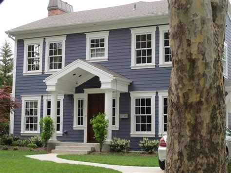blue and white house exterior update blue siding white trim wood door